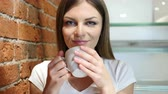 гидратация : Portrait of Young Woman Drinking Coffee from Cup Стоковые видеозаписи