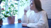 hidrasyon : Relaxing Woman Drinking Coffee while Sitting in Office