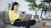 social worker : Woman Using Smartphone, Browsing online while Sitting on Couch