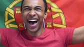 лига : Portuguese Fan celebrates holding the flag of Portugal in Slow Motion