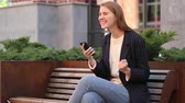 преуспевать : Business Woman Celebrating Success while Using Smartphone