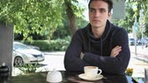 терраса : Young Man Sitting in Cafe Terrace