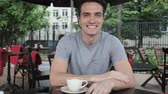 терраса : Smiling Young Man Sitting in Cafe Terrace Стоковые видеозаписи