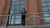investidor : Businessman in Suit Standing Outside Loft Office Vídeos