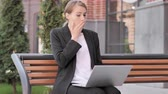 kucak : Young Businesswoman in Shock while Working on Laptop Outdoor