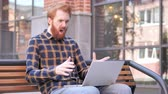 redhead : Man Frustrated by Results, Sitting Outside Office