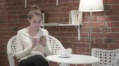 refrescarse : Woman having Coffee and Celebrating Success on Smartphone Archivo de Video