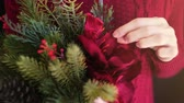 de amor : Female wear red sweater holding christmas flower bouquet.