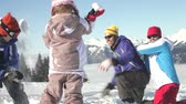 śnieżka : Mother, father and two children throwing snowballs and laughing. Wideo