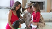 militar : Family playing together as girl takes boys hand and places it on pregnant mother Vídeos