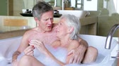 роскошь : Senior Couple Relaxing In Bath Together