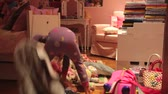se divertindo : Time-Lapse Sequence Of Girl Moving Toys To Make Bed On Floor