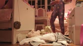 pajamas : Time-Lapse Sequence Of Girl Playing With Toys In Bedroom Stock Footage