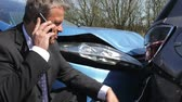Businessman Making Phone Call After Traffic Accident Stock Footage
