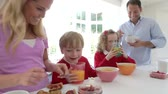 food and drink : Family Having Breakfast In Kitchen Together Stock Footage