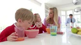 four people : Family Having Breakfast In Kitchen Together Stock Footage