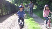 dolly : Family On Cycle Ride In Countryside Stock Footage