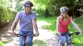 dolly : Young Couple On Cycle Ride In Countryside Stock Footage