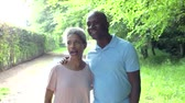 african : Mature African American Couple Walking In Countryside