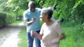 dráha : Mature African American Couple Running Along Country Path