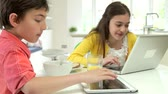 dolly : Children With Digital Tablet And Laptop At Breakfast Stock Footage