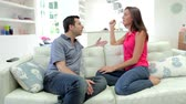 aborrecido : Hispanic Couple Sitting On Sofa Having Argument Stock Footage