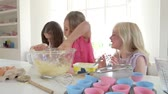 farinha : Three Little Girls Making Cake Together Stock Footage