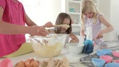 misturando : Three Little Girls Making Cake Together Stock Footage