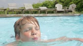 tendo : Young Boy Swimming In Outdoor Pool