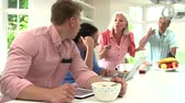 aborrecido : Family With Adult Children Having Argument At Breakfast  Stock Footage