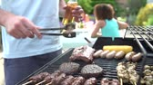 hambúrguer : Close Up Of Of Man Cooking On Barbeque At Home Stock Footage