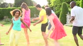 pontapé : Slow Motion Sequence Of Friends Playing Football In Garden