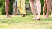 prato : Slow Motion Sequence Of Feet Having Fun In Garden