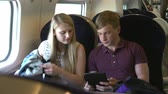 sáně : Teenage Couple Using Digital Devices On Train Journey Dostupné videozáznamy