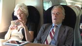 first class : Two Senior Businesspeople Commuting On Train Stock Footage