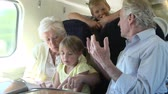 sáně : Grandparents And Grandchildren Relaxing On Train Journey Dostupné videozáznamy