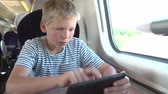 sáně : Boy Reading E Book On Train Journey