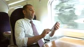 first class : Businessman Commuting On Train Reading E Book