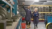 internar : Worker And Apprentice Checking Stock Levels In Store Room