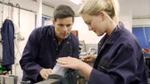 industry : Apprentice Using Metal File On Factory Floor