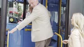 passar : Woman Helping Senior Man To Board Bus Vídeos