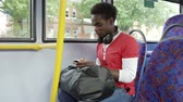 americano africano : Passenger Leaving Mobile Phone On Seat Of Bus Stock Footage
