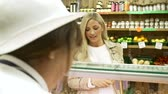 supermarket : Female Sales Assistant Serving Customer In Delicatessen