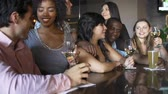 boates : Group Of Friends Enjoying Drink At Bar Together