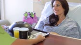 americano africano : Female Patient Being Served Meal In Hospital Bed