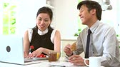 years : Asian Couple With Laptop And Newspaper At Breakfast Stock Footage