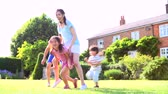 outdoors : Asian Family Playing In Summer Garden Together