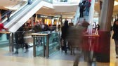 consumismo : Time Lapse Sequence Of Shoppers On Escalators In Mall