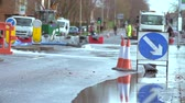 cuidado : Water Being Pumped From Flooded Road Junction