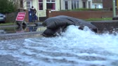 tubos : Slow Motion Sequence Of Pumping Water From Flooded Road Vídeos